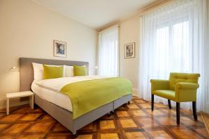 Ein Bett oder Betten in einem Zimmer der Unterkunft Hotel Schmid & Alfa