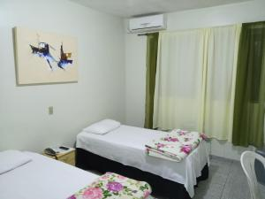 A bed or beds in a room at Hotel Gran Fenícia Marechal