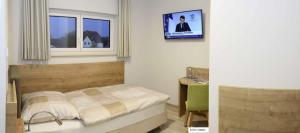 Ein Bett oder Betten in einem Zimmer der Unterkunft Landgasthof Vogt