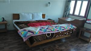 A bed or beds in a room at Hotel Sodizang Retreat