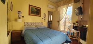 A bed or beds in a room at B&B La Casa Di Bruno