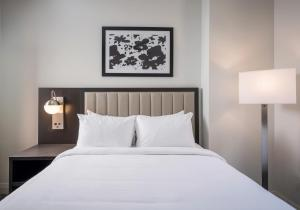 A bed or beds in a room at The Grove Resort & Water Park Orlando
