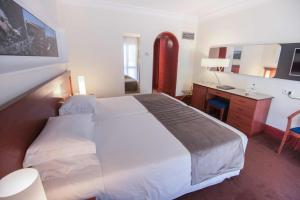 A bed or beds in a room at Azoris Faial Garden – Resort Hotel