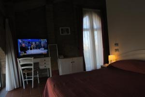 Letto o letti in una camera di Blue Garibaldi Room & Breakfast
