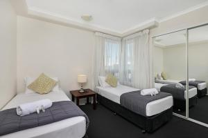 A bed or beds in a room at Neptune Resort