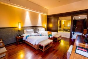 A bed or beds in a room at Landmark Mekong Riverside Hotel