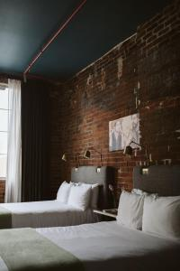 A bed or beds in a room at The Old No. 77 Hotel & Chandlery