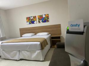 A bed or beds in a room at Hotel QualitySul