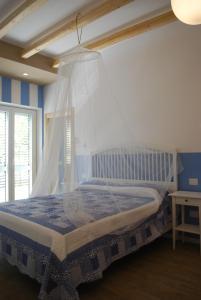 Letto o letti in una camera di Casa Polly B&B
