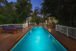 The swimming pool at or near Weezie's Ocean Front Hotel and Garden Cottages