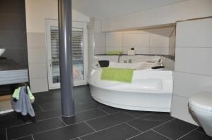 Ein Badezimmer in der Unterkunft Destimotel