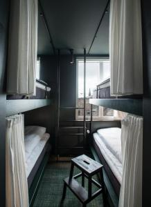 A bunk bed or bunk beds in a room at Hotel Danmark by Brøchner Hotels
