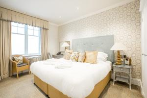 A bed or beds in a room at The Headland Hotel and Spa