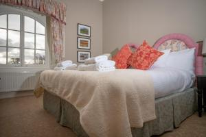 A bed or beds in a room at Coul House Hotel