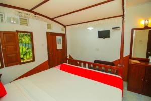 A bed or beds in a room at Hotel Nawathana