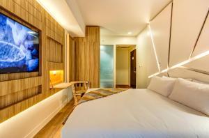 Cama ou camas em um quarto em Hotel Nodo - Primer hotel explorador urbano