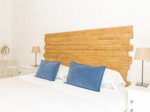 A bed or beds in a room at Dulces Dreams Boutique Hostel
