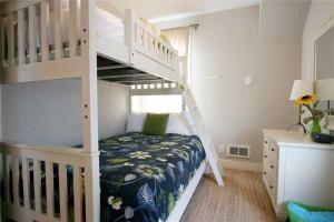 A bunk bed or bunk beds in a room at Big Fish Two-Bedroom Home