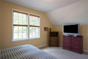 A television and/or entertainment center at Clamdigger Cottage Three-Bedroom Home