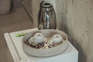 Coffee and tea-making facilities at Adi Bisma Inn