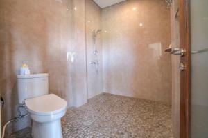 A bathroom at Adi Bisma Inn