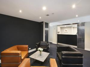 A seating area at Sydney Airport Suites