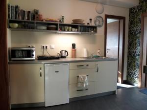 Kuchyňa alebo kuchynka v ubytovaní Vila Tiesňava Slovenský raj