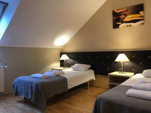 A bed or beds in a room at Mäetaguse Manor Hotel & Spa