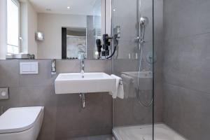 Ein Badezimmer in der Unterkunft Parkhotel Schmid