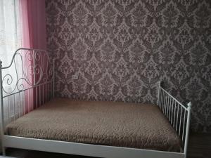 Кровать или кровати в номере Апартаменты на Уральской