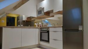 A kitchen or kitchenette at Appartement confortable et design en hyper centre