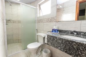 Um banheiro em Hotel Marbor
