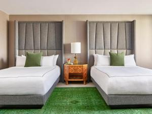 A bed or beds in a room at Viceroy Washington DC