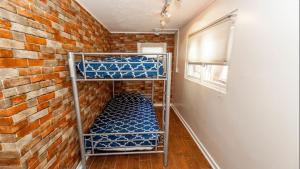 A bunk bed or bunk beds in a room at The Beach Waikiki Boutique Hostel