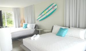 A bed or beds in a room at Aqua Hotel