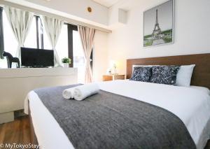 Cama o camas de una habitación en Studio Vacation Apartment, 5 mins to SHIBUYA Crossing-Hachiko! CS1 008
