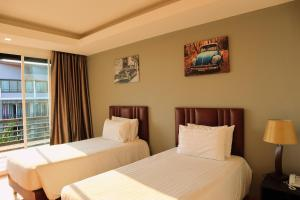 A bed or beds in a room at Aranta Airport Hotel
