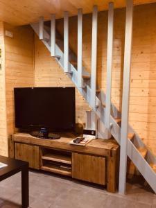 Télévision ou salle de divertissement dans l'établissement Le duplex De La Ferme Du Tertre