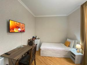 A bed or beds in a room at TravelStay