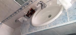Ein Badezimmer in der Unterkunft Hotel Garni Concordia - Dolomites Home