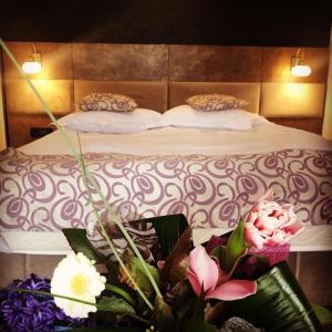 Vuode tai vuoteita majoituspaikassa Hotel Corsa