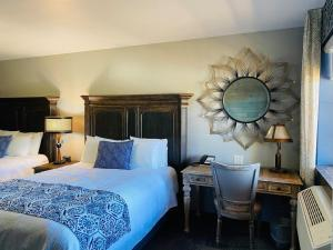 A bed or beds in a room at Desert Rose Resort & Cabins