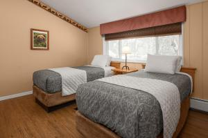A bed or beds in a room at Chena Hot Springs Resort