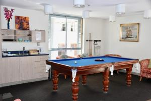 A pool table at Mariners Court Hotel