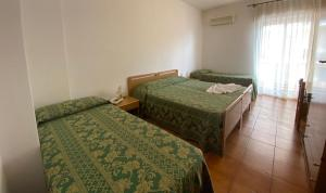 A bed or beds in a room at Hotel Soleado