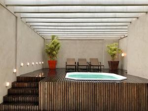 The swimming pool at or close to Flat pensado para sua tranquilidade e alegria