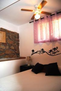 Cama o camas de una habitación en A Orillas Del Lago