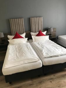 Een bed of bedden in een kamer bij Hotel Rahserhof