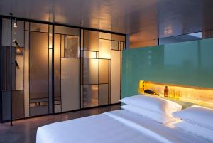 A bed or beds in a room at Casa Habita