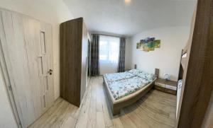 Posteľ alebo postele v izbe v ubytovaní Apartmán Pod Klinom